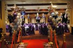 The tables were beautifully adorned with sky blue tablecloths, over a hundred royal purple chair covers and Balloons galore!